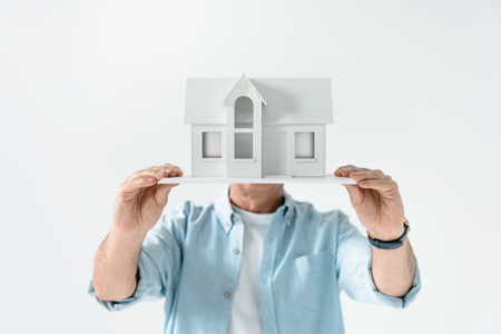 obscure: obscure view of man showing house model Stock Photo
