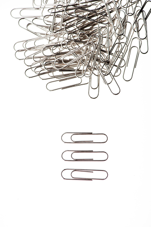 pile of paper clips on white background Stock Photo - 76608527
