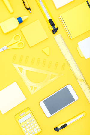 Top view of smartphone, calculator and office supplies Stock Photo