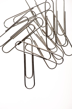 pile of paper clips on white background Stock Photo