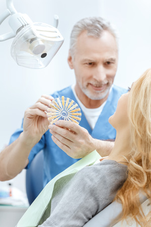 dentist matching teeth colour with palette Stock Photo