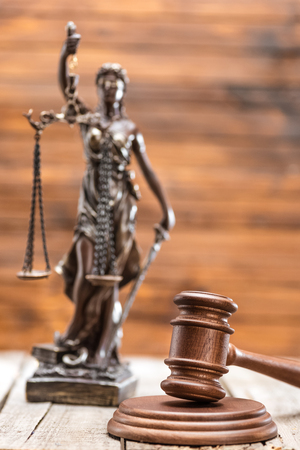 Close-up view of statue of lady justice and mallet, Law concept Stock Photo