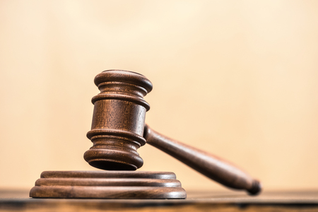 Close-up view of brown wooden mallet of judge, law concept Stock Photo
