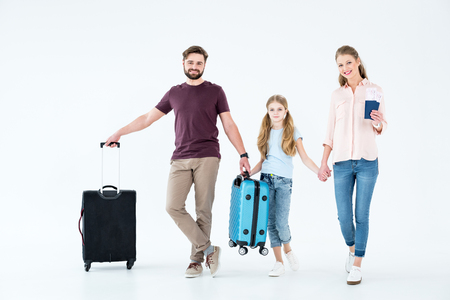 young family with passports, tickets and traveling bags Stock Photo