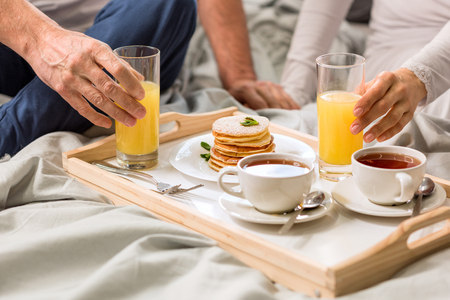 Cropped shot of couple having breakfast together Stock Photo