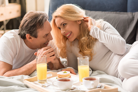 Happy middle aged couple having breakfast together