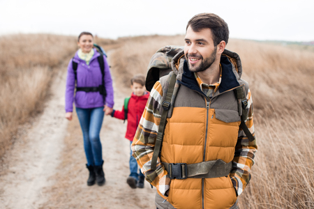 Man with wife and son backpacking