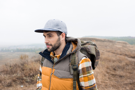 Young bearded man with backpack Stock Photo