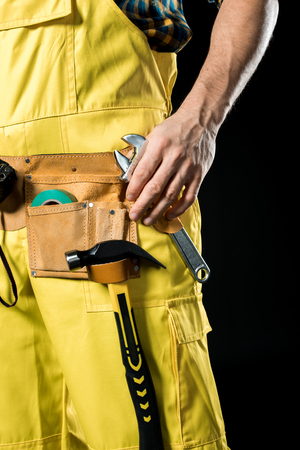 Workman in tool belt Stock Photo