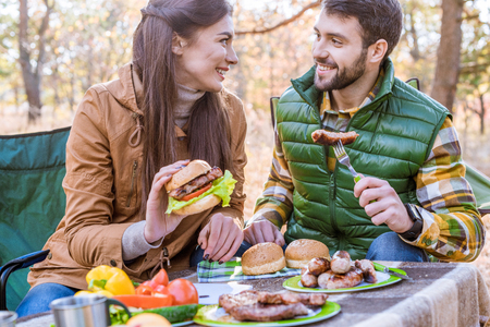 Smiling young couple on picnic Stock Photo