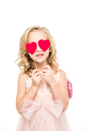 Girl holding red hearts