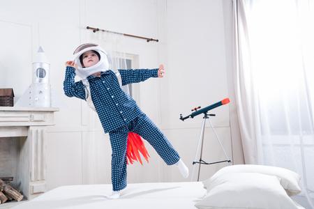 little boy in space helmet playing astronaut Stok Fotoğraf
