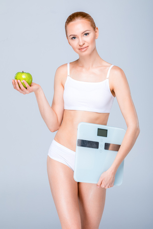 Woman with digital scales Stock Photo