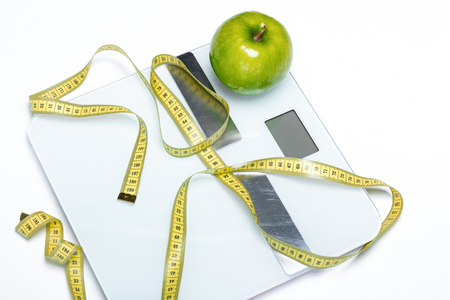 Digital scales and measuring tape Stock Photo