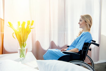 smiling wheelchair woman in hospital chamber Stock Photo