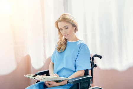 wheelchair woman reading book in hospital Stock Photo