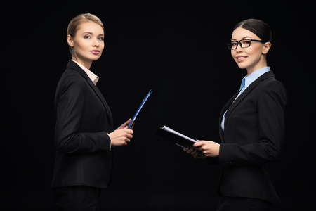 business people connecting during work and using clipboards, business teamwork