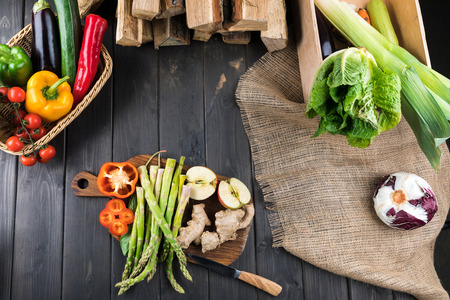 fresh vegetables on rustic wooden background Banco de Imagens