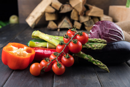 fresh seasonal vegetables on rustic wooden table