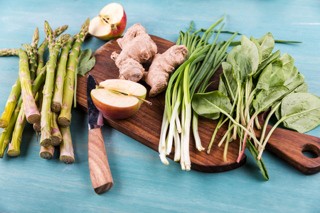 fresh seasonal vegetables on wooden table top texture
