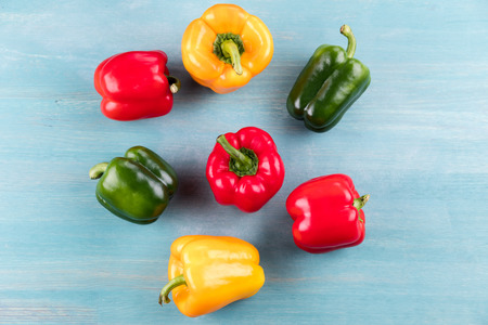 fresh ripe peppers on blue wooden table background Banco de Imagens
