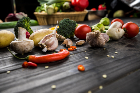 fresh seasonal vegetables on wooden table background Фото со стока