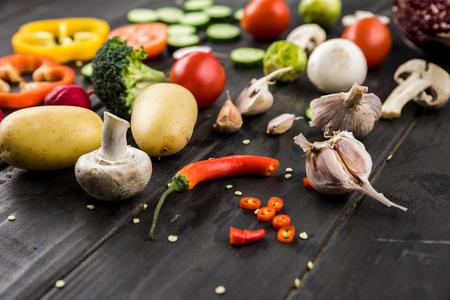 fresh seasonal vegetables on wooden table background Banco de Imagens
