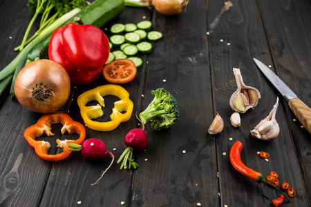 fresh seasonal vegetables on rustic wooden background