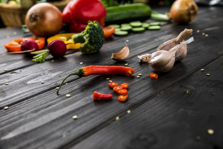 fresh seasonal vegetables on rustic wooden background