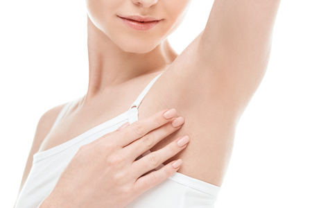 woman showing armpits isolated on white. skin care woman concept