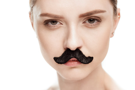 beautiful young woman with black mustaches looking at camera