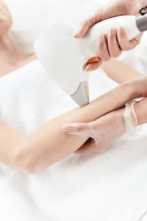woman receiving laser skin care on hand