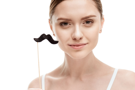 beautiful young woman with black mustaches on stick Imagens