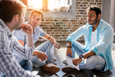 young professional group working on new business project in small business office Stock Photo