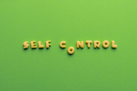self controt concept, words made of cookies isolated on green