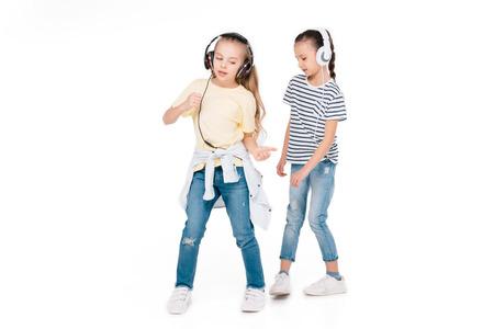 Kids in headphone listening music Stock Photo