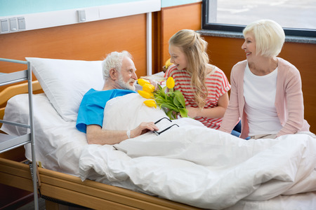 grandmother and granddaughter visiting patient