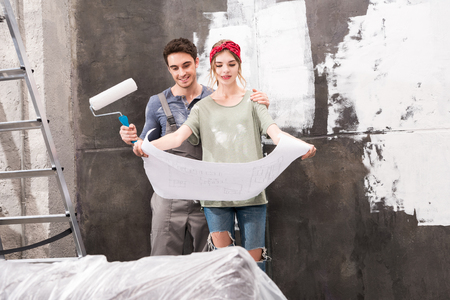 schemes: couple looking at schemes while renovation home