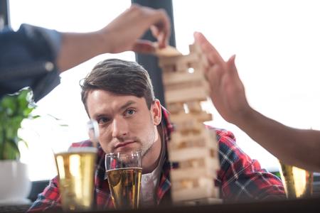 men playing wooden block game