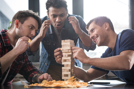 young people playing wooden block game