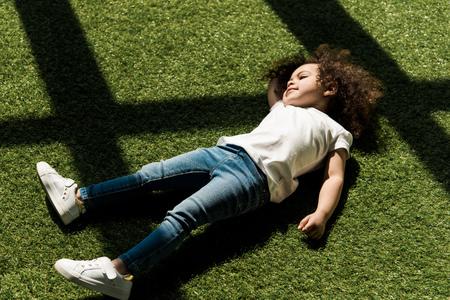 girl lying on grass Stok Fotoğraf