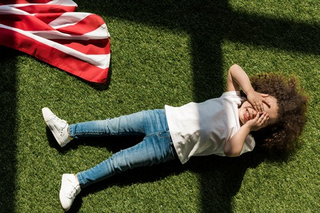girl lying on grass Stock Photo