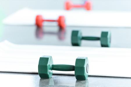 Dumbbells on floor in gum Reklamní fotografie