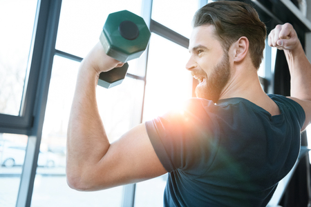 young guy workout with dumbbell