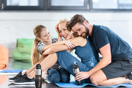 Happy family resting after workout