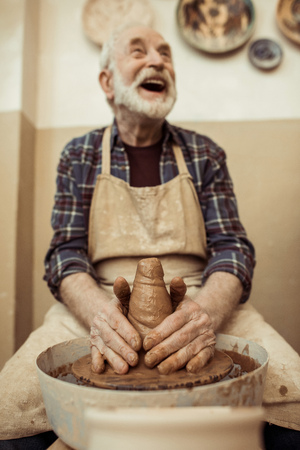 male craftsman working on potters wheel