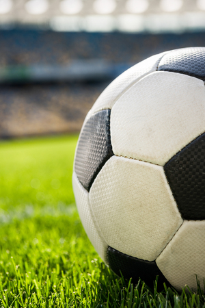 soccer ball on grass on soccer field stadium