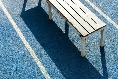 bench on running track on   stadium Stok Fotoğraf