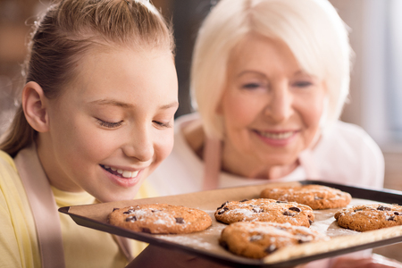 Grandmother and grandchild with cookies Stock Photo