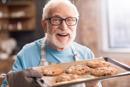 Senior man with cookies Stok Fotoğraf